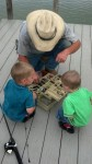 The kids learning about fishing.